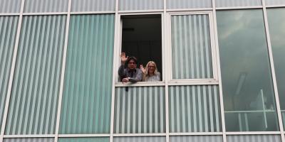 Domen & Maja waving from the new office