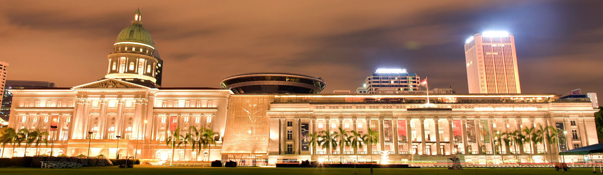 Lit front facade of the Supreme Court building in Singapore