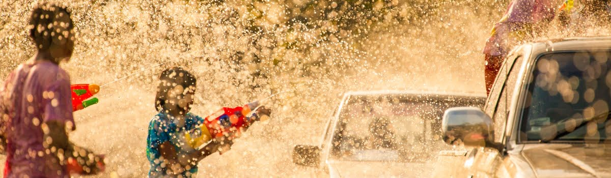 New Year in Asia-Featured photo- splashing water during Songkran