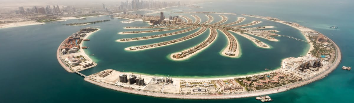 Aerial view of artificial palm island in Dubai. Panoramic view.