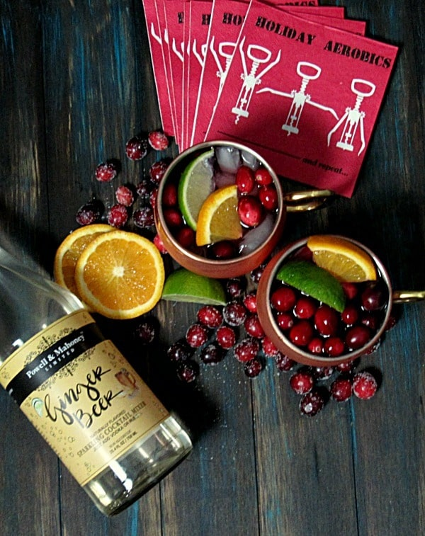 Cranberry Moscow Mule: a holiday version of a classic-the perfect blend of vodka, ginger beer, fresh lime, orange and cranberry juices.