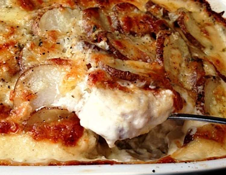 Easy Au Gratin Potatoes ~ creamy, cheesy sauce, tender slices of layered potatoes, golden brown slightly crispy top. The ideal side for any meal.