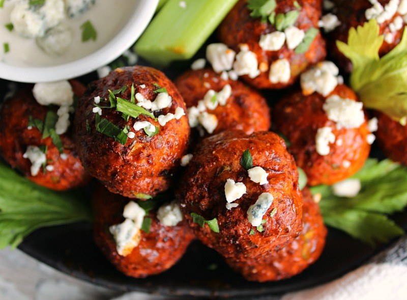 buffalo chicken meatballs garnished with crumbled blue cheese + side of ranch dressing