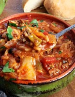 green bowl with stuffed cabbage soup