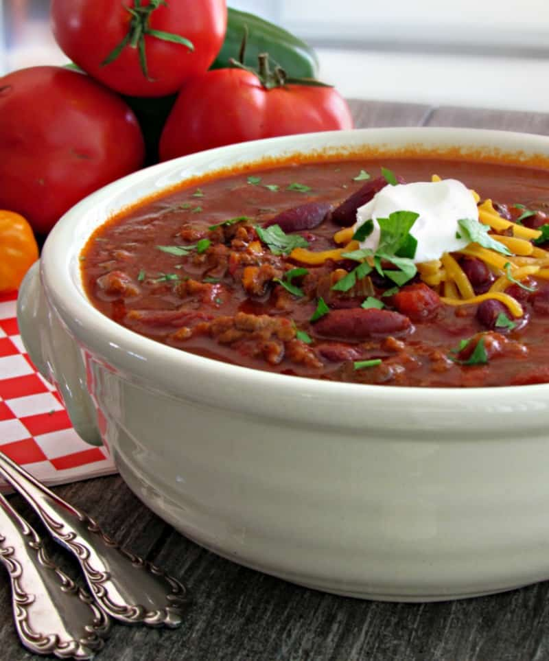 Quick and easy ground beef chili ~ slow cooker and stovetop options. Loaded with beef, beans and bold flavor.