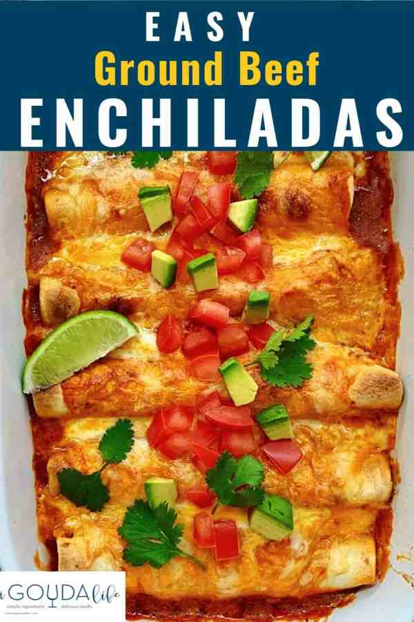 pinterest pin showing closeup of pan of baked enchiladas with melted cheese garnished with chopped tomatoes and avocado