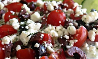 Easy Greek Layered Dip as a healthy appetizer or add grilled chicken for an any night meal ~ layered hummus, tzatziki, tomatoes, olives and Feta cheese.