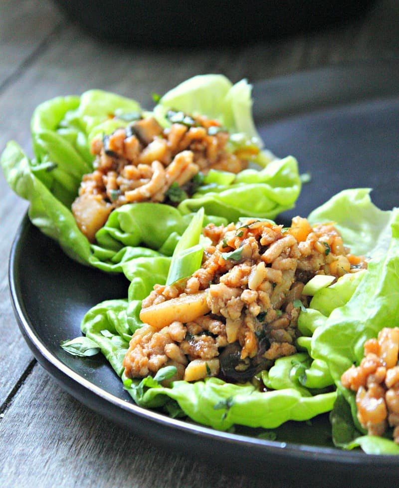 ground chicken lettuce wraps on black plate