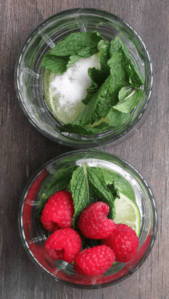 Raspberry Mojito ~ a refreshing twist on the classic Mojito ~ tangy lime, a blast of cool, refresthing mint, a little sugar + fresh summer berries.