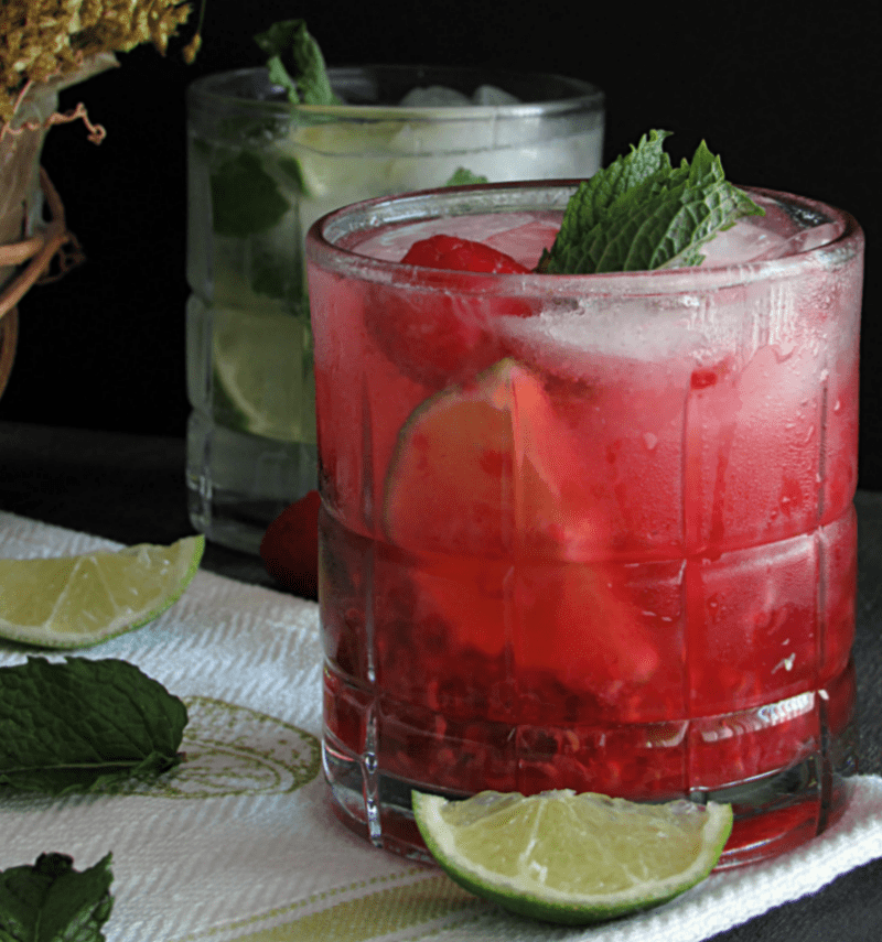 side view of raspberry and classic mojitos garnished with mint
