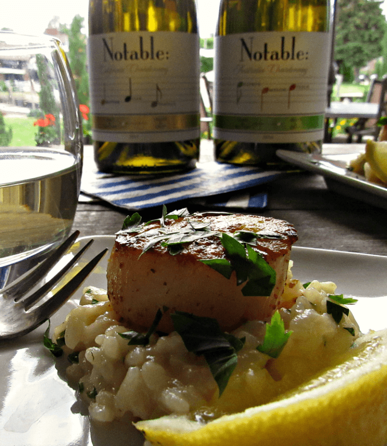 Garlic Butter Scallops Appetizer: tender, pan-seared scallops in a light, lemony garlic butter sauce. Serve alone or nestled in risotto.