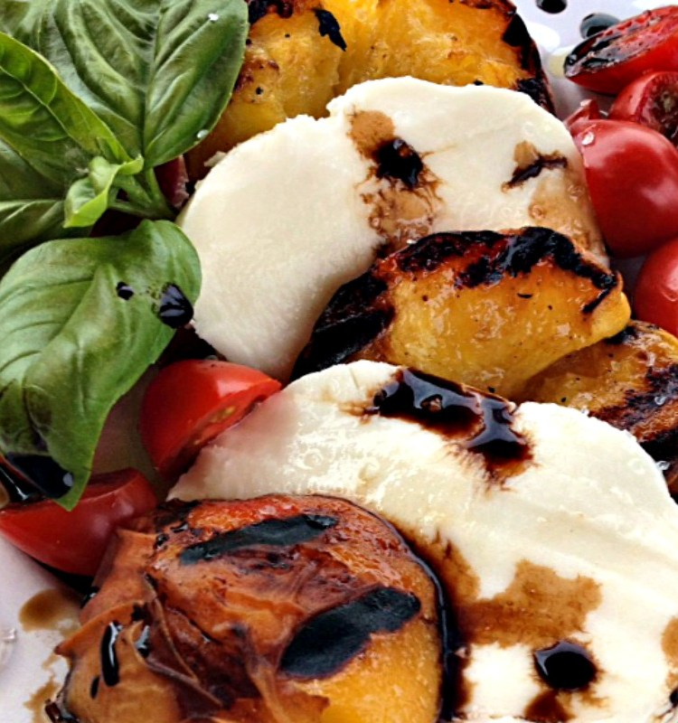 Grilled Peach Caprese ~ fresh sweet peaches grilled and layered with tomatoes, fresh mozzarella and basil for an easy summer appetizer or salad.