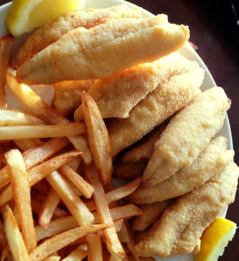 white plate with fried perch and french fries