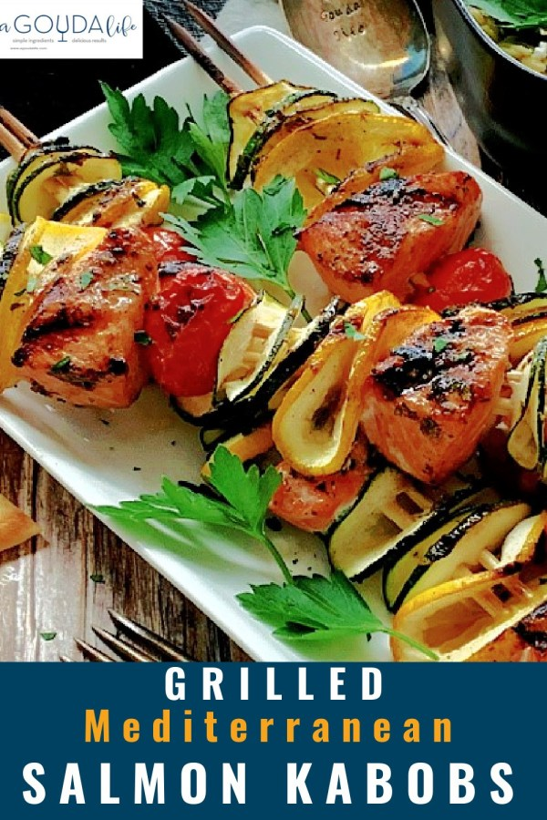 pinterest pin showing closeup of salmon and vegetable skewers