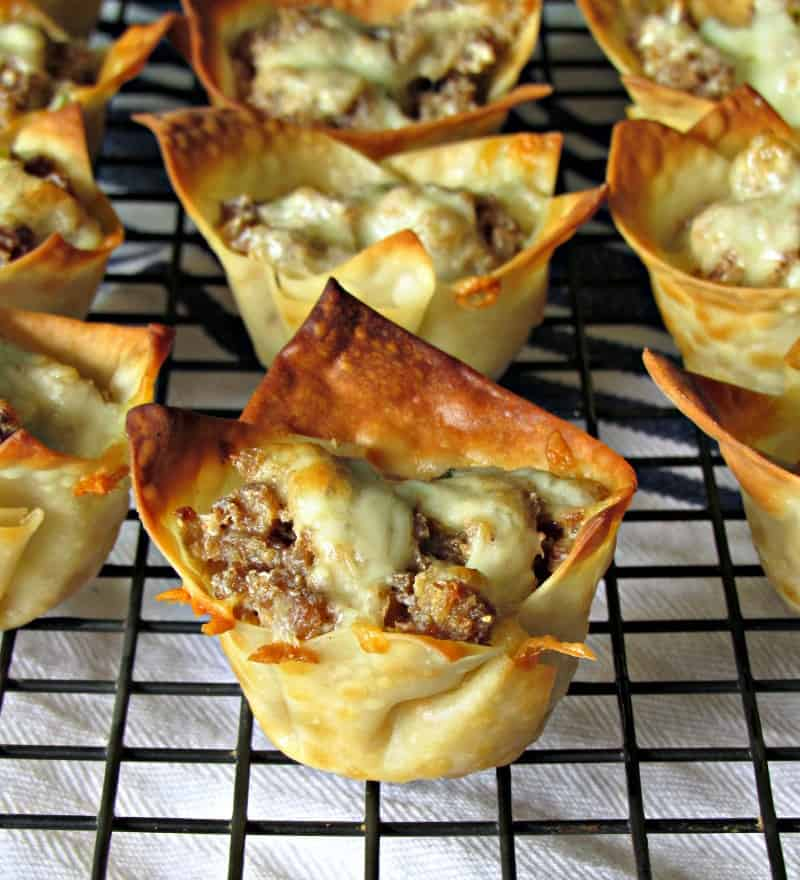 Bite size crispy baked wonton cups filled with sausage and cheese.