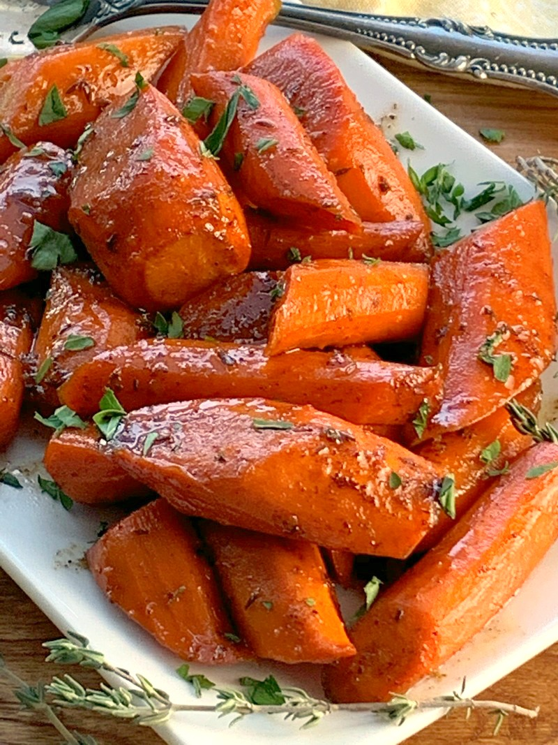 white plate with chopped glazed carrots