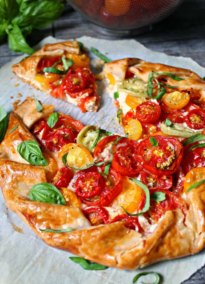 sliced galette with fresh tomatoes and herbs