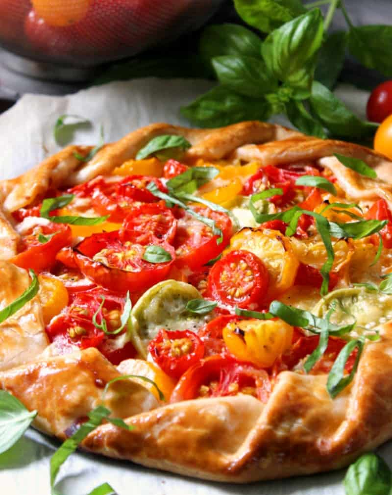 whole tomato galette garnished with sliced basil.