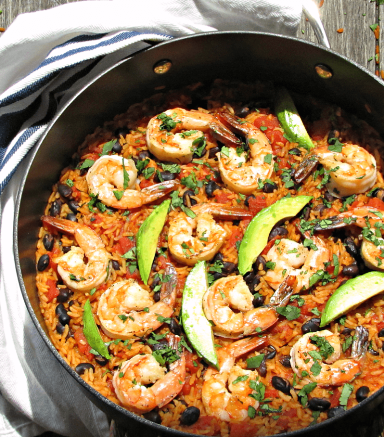 Spanish Shrimp and Rice: 1 pan + 20 minutes = shrimp, flavor infused rice in a rich, robust, tomatoey sauce with a hint of lime, black beans and avocado.