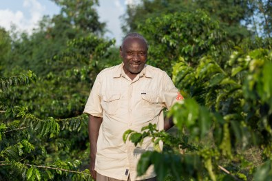 A proud farmer with his coffee trees
