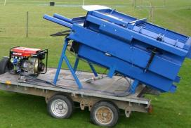 Trailer-mounted baler for waste agri-plastic compaction