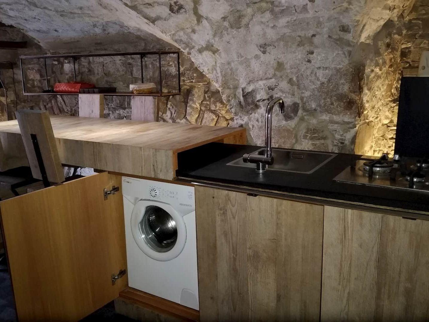 lavatrice nella cucina dell'appartamento Angolo Di Papà Gigi