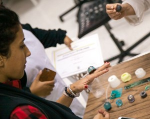 Nuqat co-founder Hussah Al Humaidhi tries on handmade jewelry by local artists.