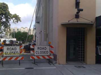 The road behind the building is closed, so I'll need to carry my bike up 2 stories