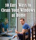 man sitting and cleaning windows at home