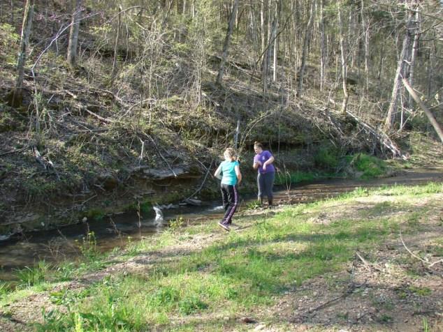 girls skipping rocks
