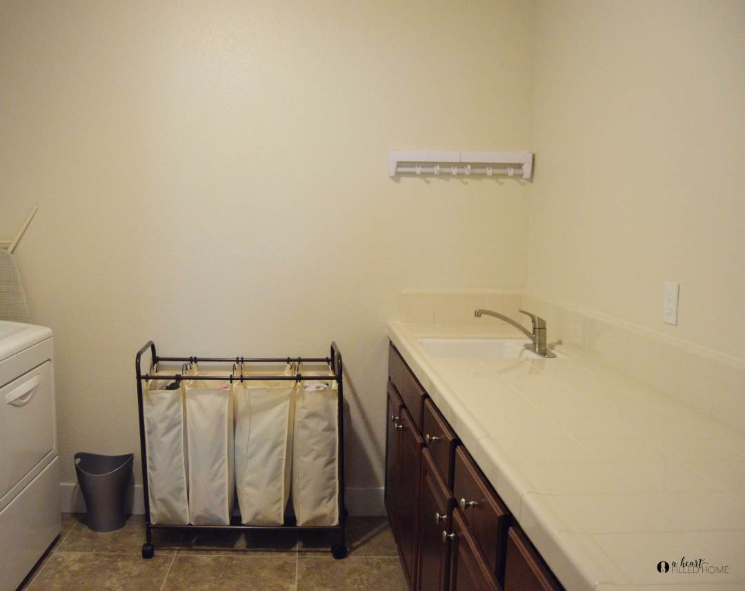 Plans for a budget friendly Farmhouse Laundry Room Makeover! from aheartfilledhome.com