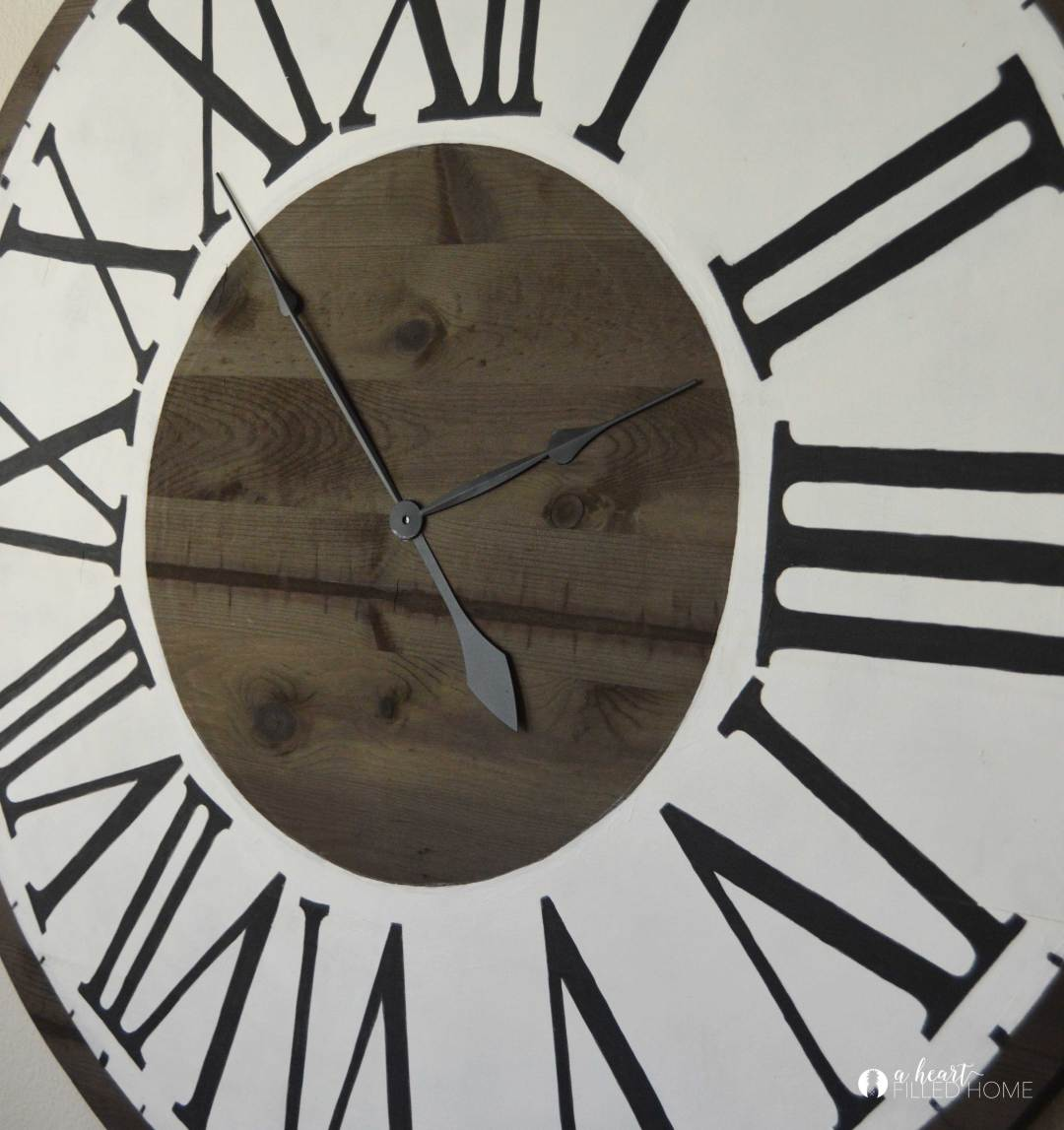 Learn how to create this beautiful DIY large Roman numeral faux clock for your home using this tutorial!
