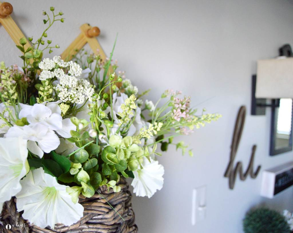A Beautiful Budget Friendly Spring Floral Basket Pinterest Challenge! A simple and easy way to create a Spring decor piece for your home! from A Heart Filled Home