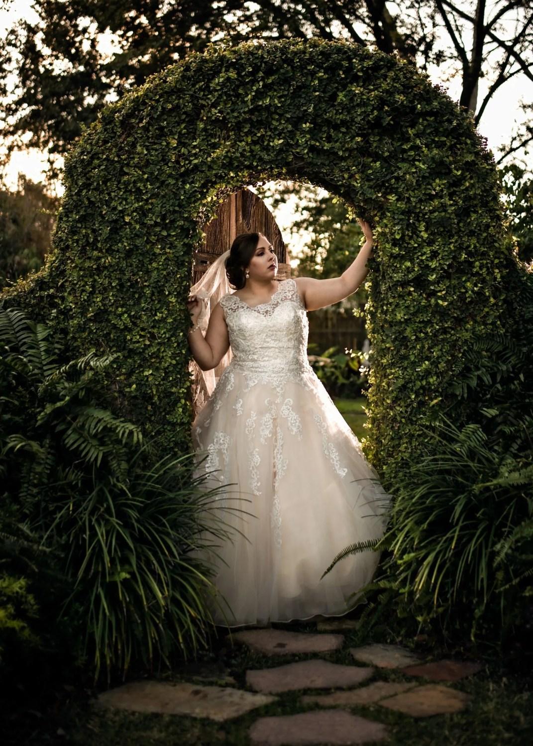 bridal photo shoot in archway at secret garden in sulphur louisiana