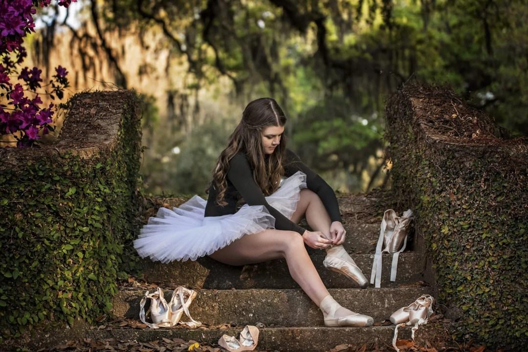 teenage ballerina senior photography in white tutu with ballet shoes