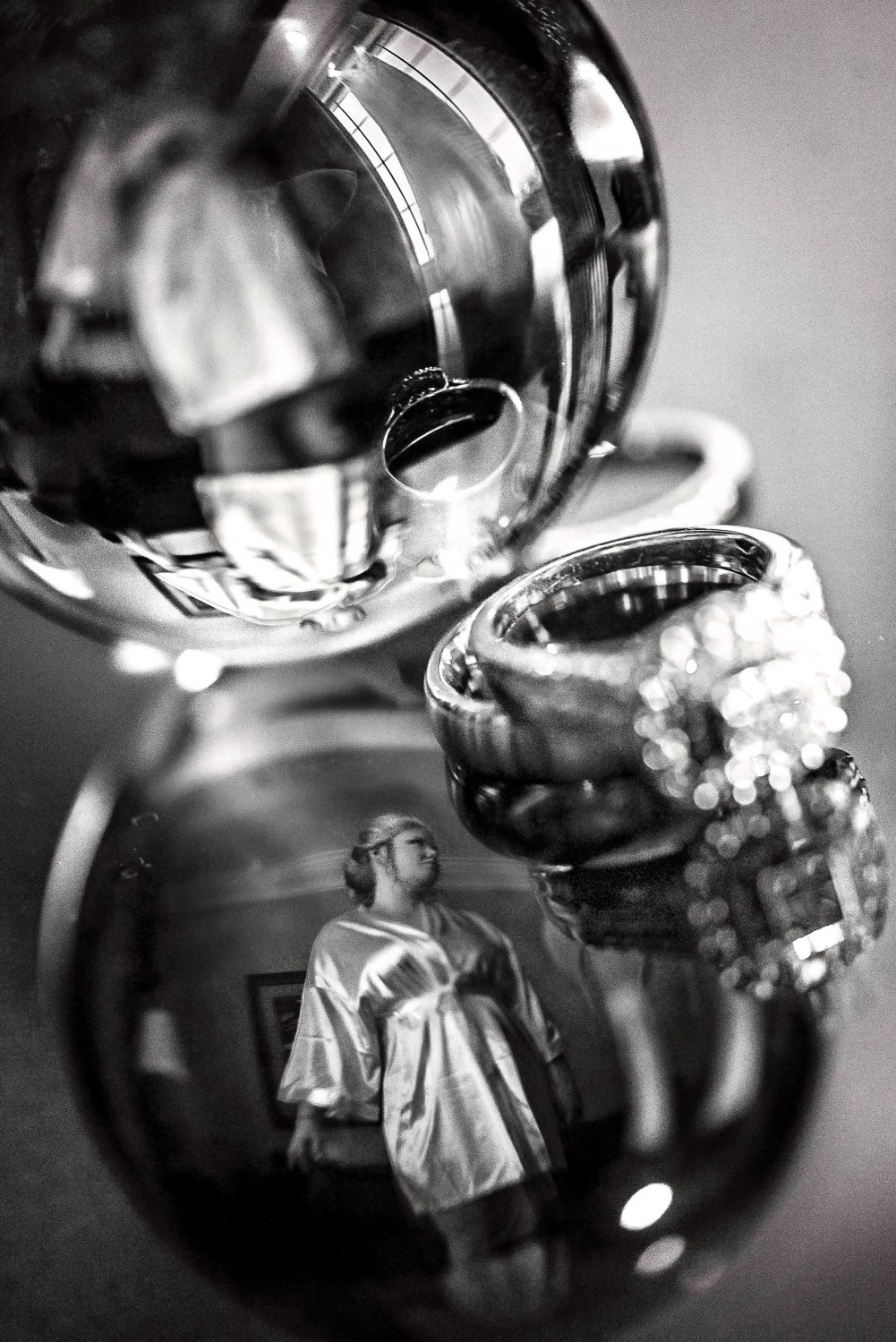 unique creative wedding photography showing bride and rings black and white