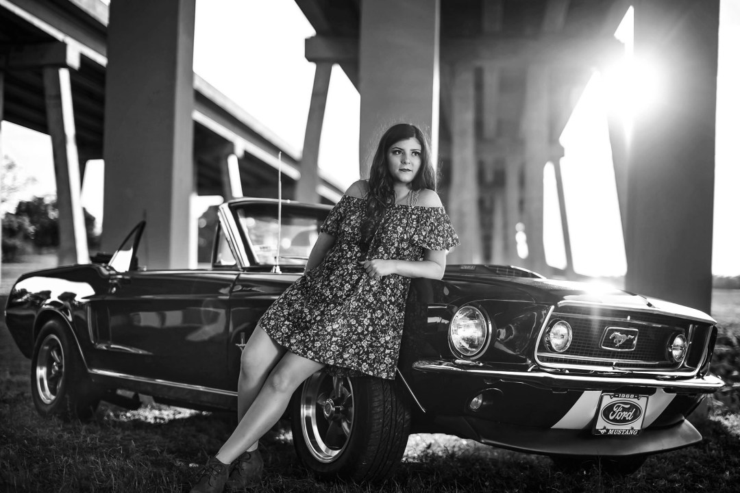 ahnvee photography award winning black and white photo of brunette and vintage car
