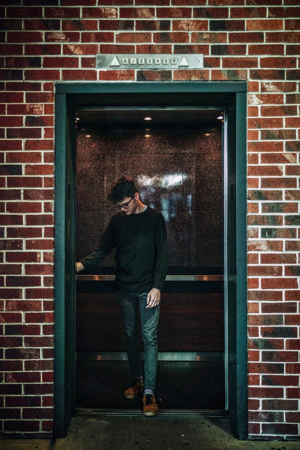 senior portrait male entering elevator