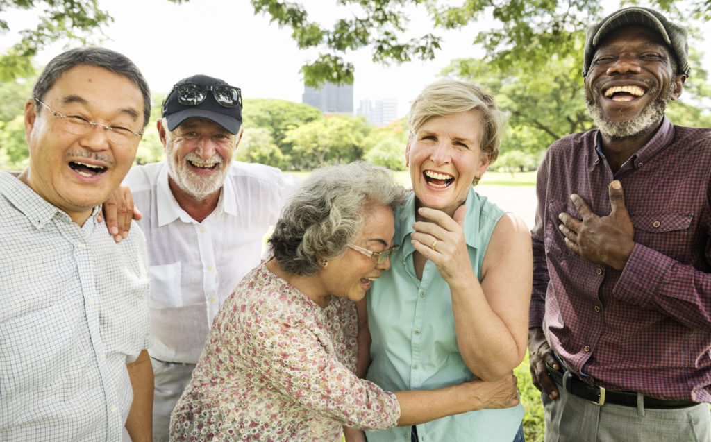 group of seniors laughing beautiful smiles cosmetic dentist arlington heights il