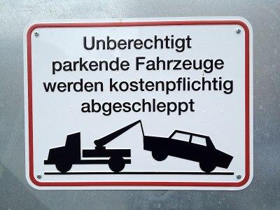 Leipzig signs: Unberechtigt parkende Autos... Illegally parked cars...