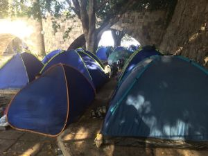 Refugees filled the beach and streets of Kos town in August