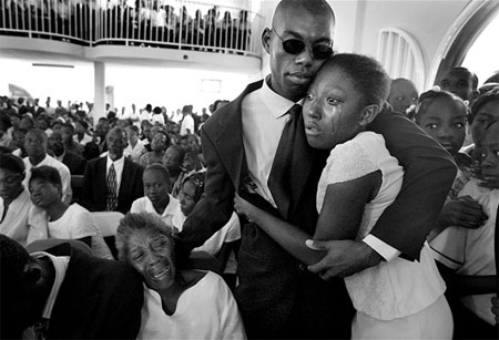 Mardoshe Thelisma cries at a funeral mass for her cousin and 90 others, who were crushed to death when the 3 story College La Promesse collapsed in Petionville outside Port-au-Prince