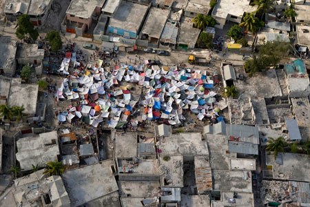 Haitians set up impromtu tent cities thorough the capital after an earthquake measuring 7.0 rocked the Haitian capital.