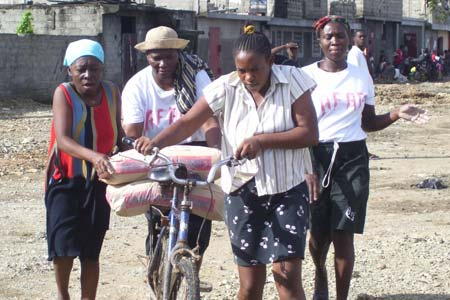 The residents of Petite-Anse transporting some of the cement for the project