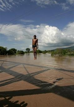 A boy jumps from a bridge into the Ulua river in El Progreso, Honduras.