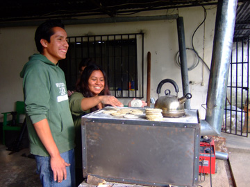 Pedro and Natalia making tortillas on the plancha