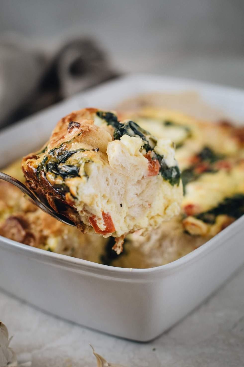 breakfast casserole slice on serving fork