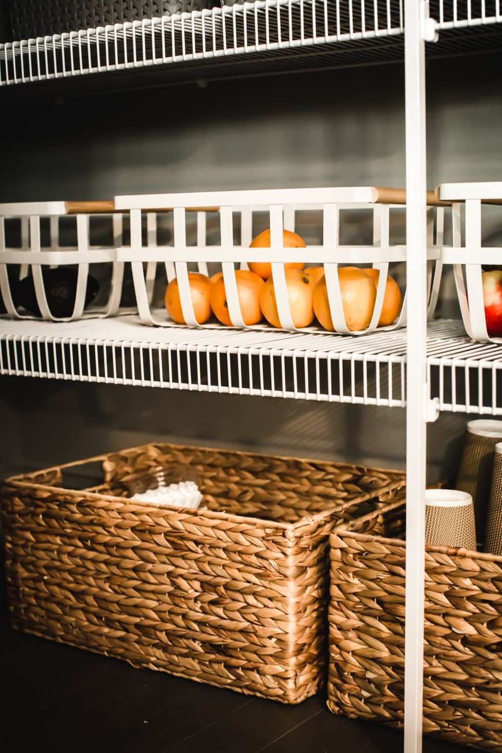 pantry shelving with basket of oranges