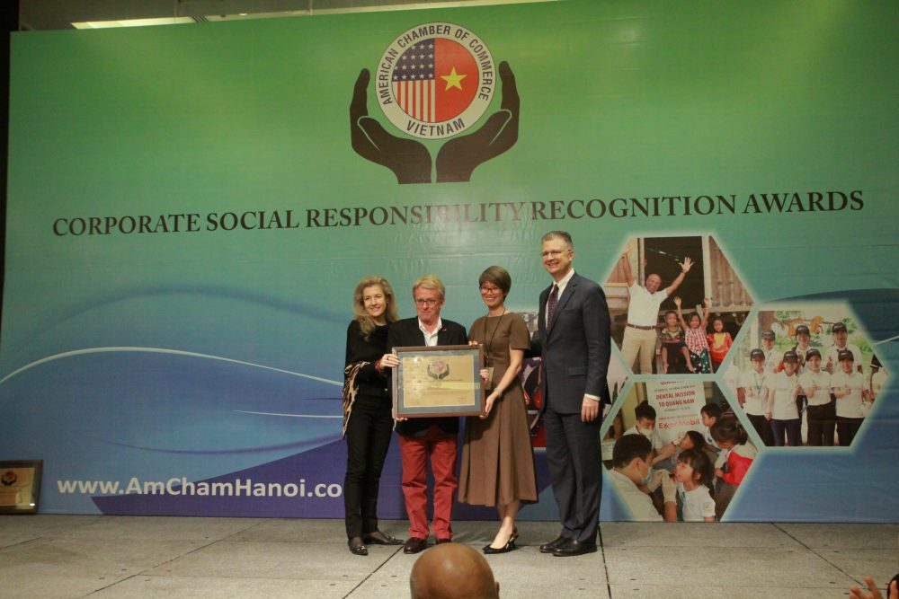 United States Ambassador Daniel J. Kritenbrink presents AIP Foundation with the AmCham CSR Award.