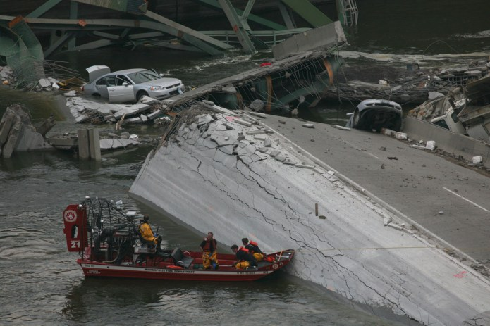 Rescue operations in Minneapolis, MN after the I-35W bridge over the Mississippi collapsed during rush hour on August 1, 2007